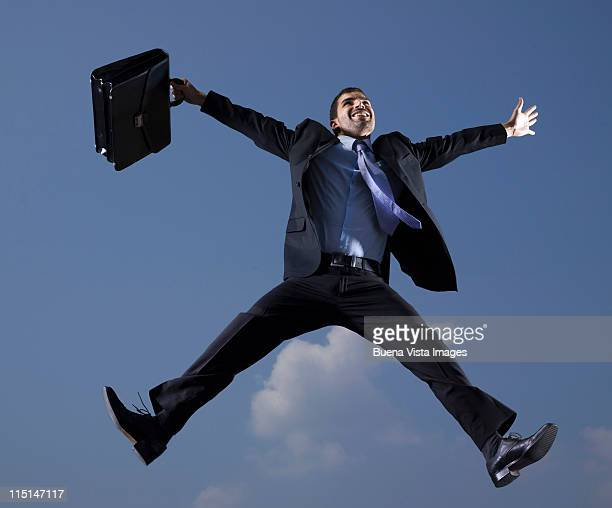 business man jumping in the air - legs apart stock pictures, royalty-free photos & images