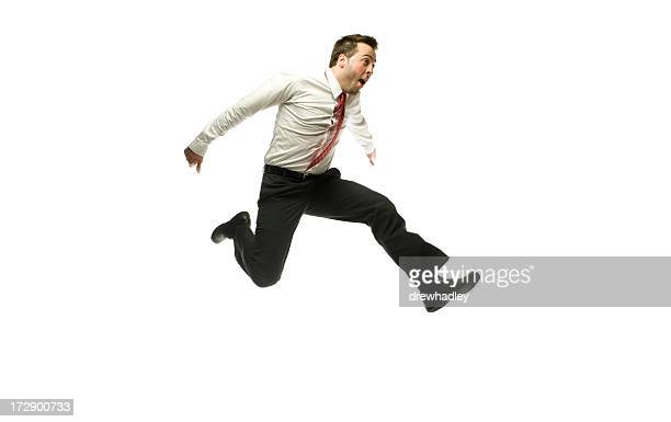 Business man jumping over obstacles.