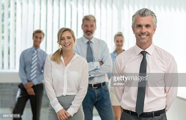 Business man leading a group at the office