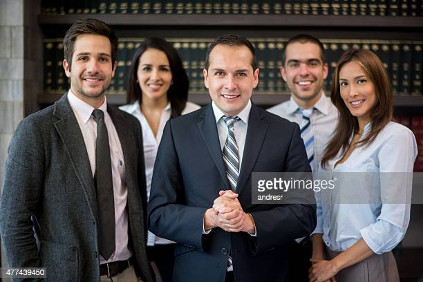 business man leading a group - law office - fotografias e filmes do acervo