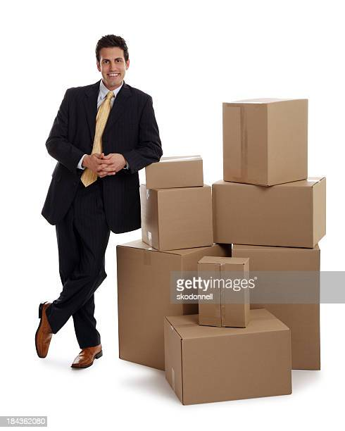 Business Man Leaning on Some Boxes