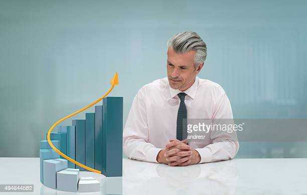Business man looking at a 3D growth graph