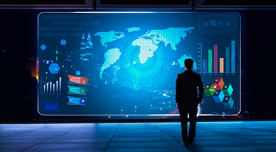 Business man looking financial graph icon on futuristic virtual screen with technology - gettyimageskorea