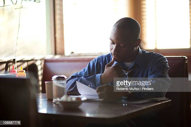 Business man looking menucard
