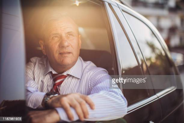 business man looking out the window of a moving car - ascot stock pictures, royalty-free photos & images