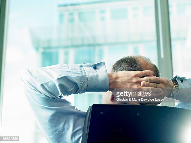 Business man looking through window
