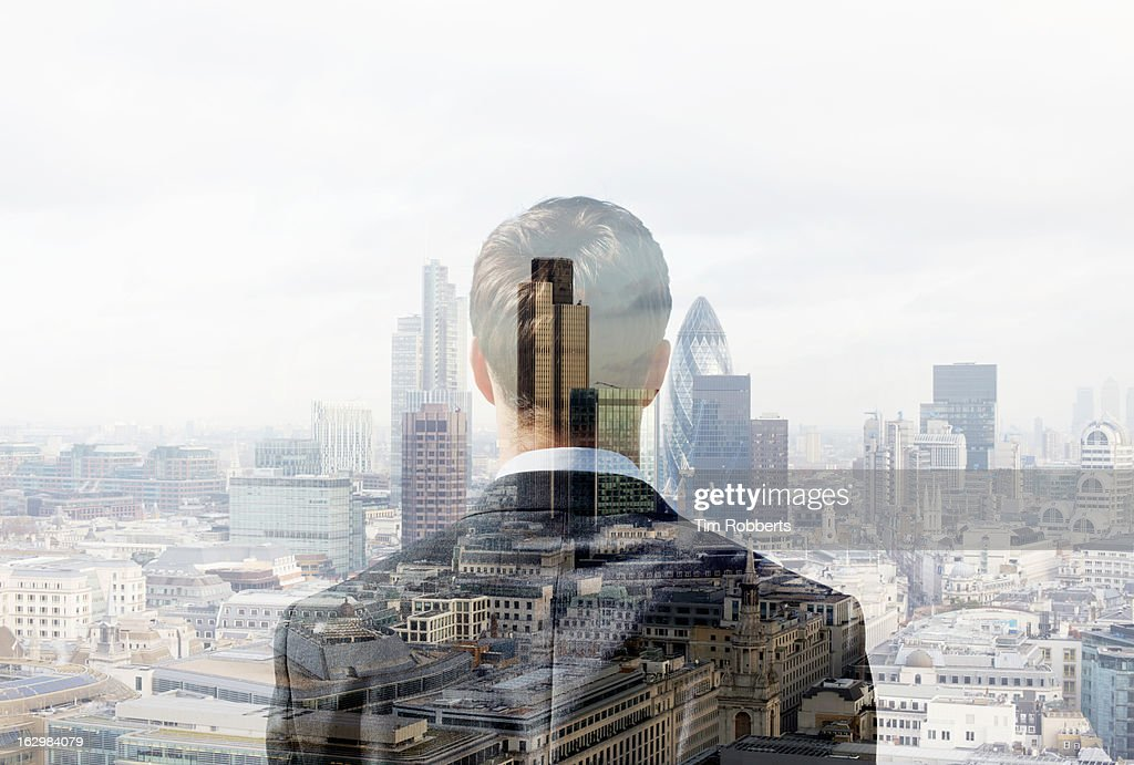 Business man looking towards the city. : Stock Photo