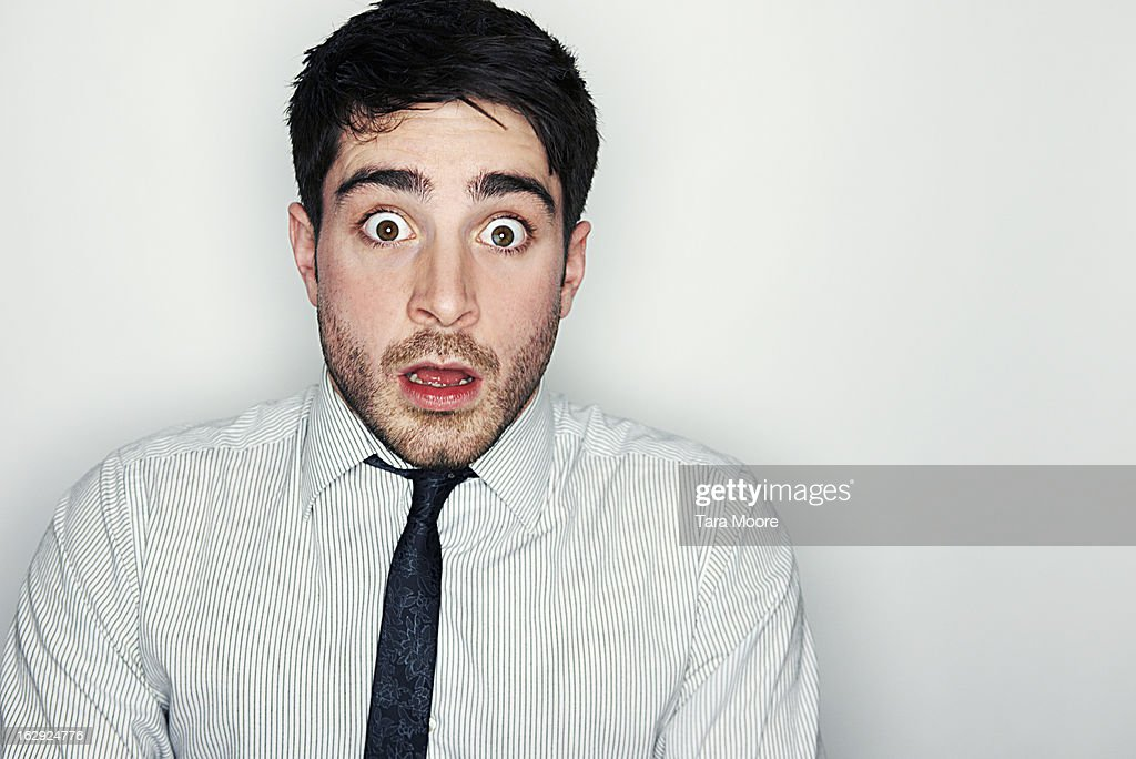 business man looking very frightened and shocked : Stock-Foto