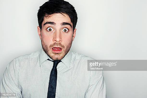 business man looking very frightened and shocked