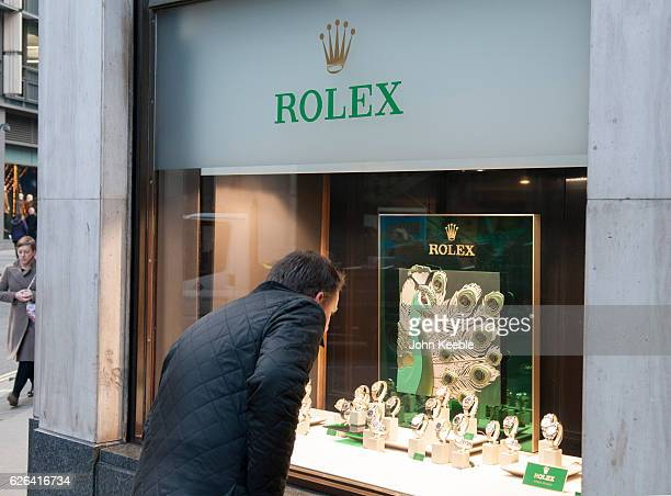 A business man looks at Rolex watches displayed in the window of a high class watch store in Fenchurch Sreet on November 22 2016 vin London United...