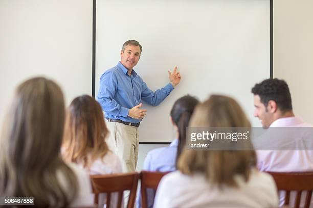 business man making a business presentation - isla reunion fotografías e imágenes de stock