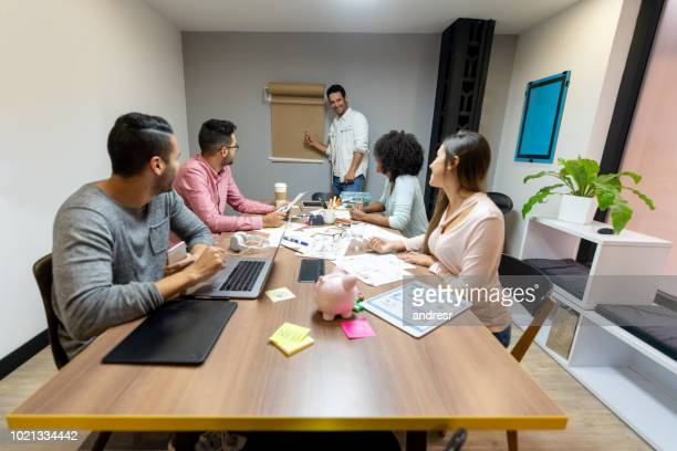 Business man making a presentation at a creative office