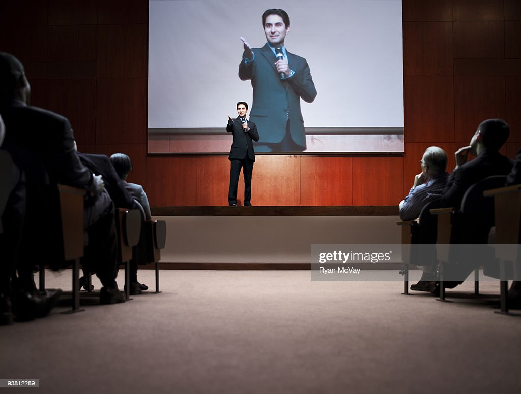 Business man making speech to crowd : Stock Photo
