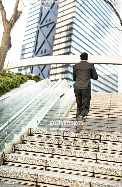 business man moving up the steps