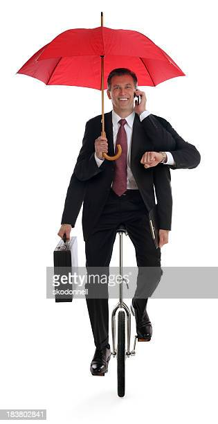 Business Man Multitasking on a Unicycle