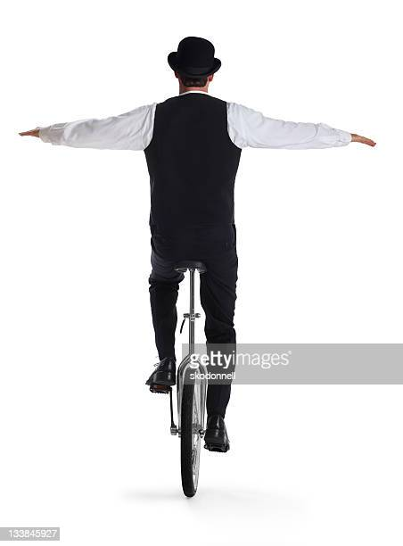 Business Man on a Unicycle Holding Arms out