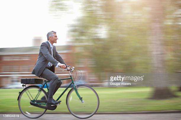 business man on bike. - carbon footprint stock pictures, royalty-free photos & images