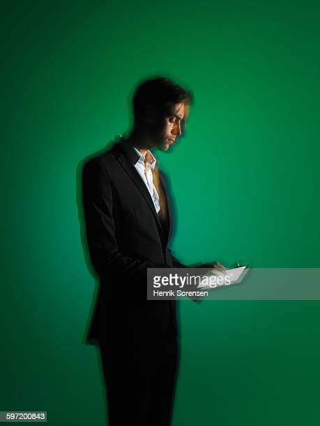 Business man on green backdrop