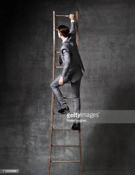 Business man on ladder