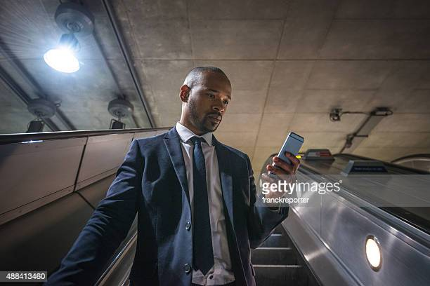 business man on the phone inside the london tube metro - portability stock pictures, royalty-free photos & images