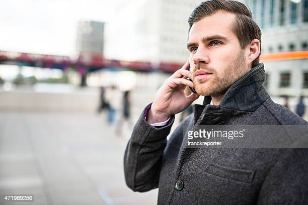 Business man on the phone on the city