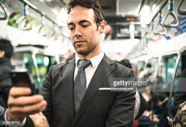 Business man on the phone on tokyo metro train