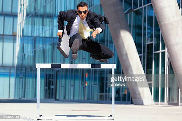 business man on the run - hurdling stock photos and pictures