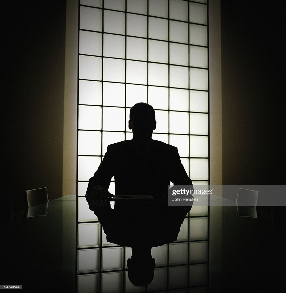 Business man or boss in silhouette interview : Stock Photo