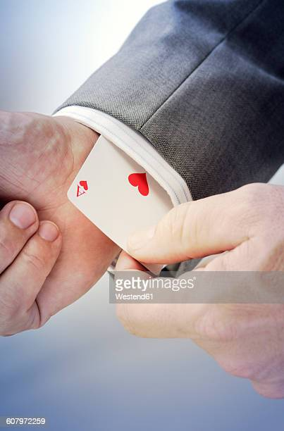 Business man, playing card with heart and ace