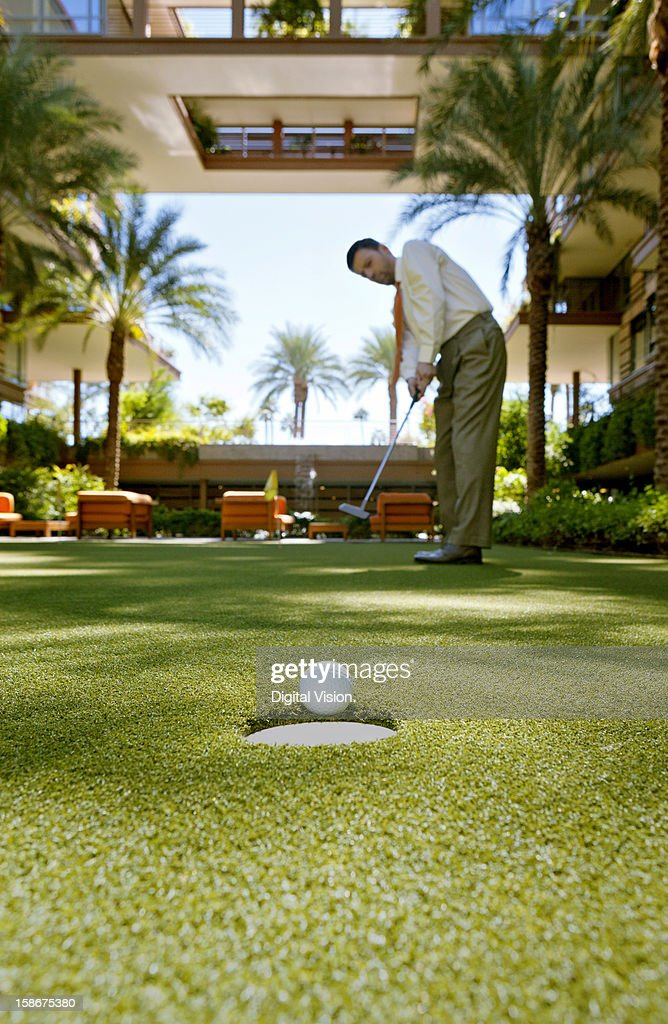 Business man playing golf : Stock Photo