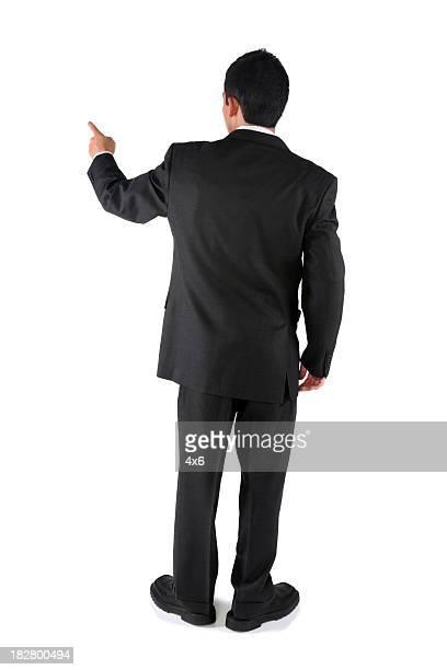 Business man pointing facing away