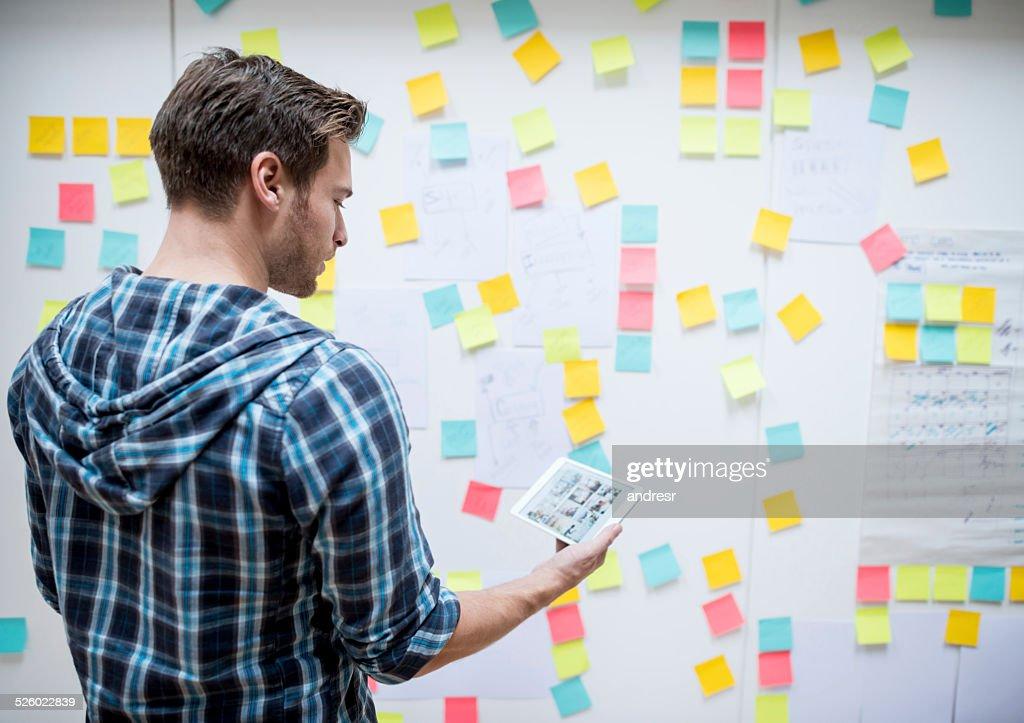 Business man posting ideas : Stock Photo