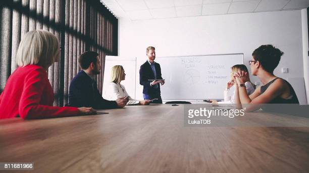 business man presenting new ideas and projects to his team - truth be told stock photos and pictures