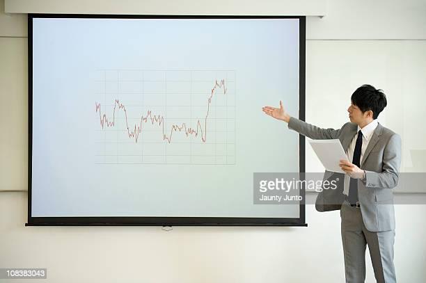 business man presenting using a praph - プレゼン ストックフォトと画像