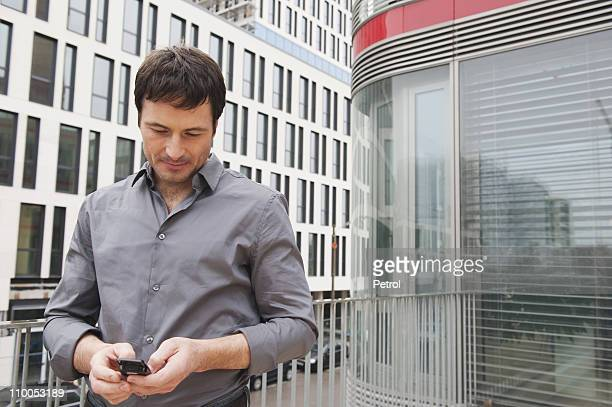 Business man reading sms