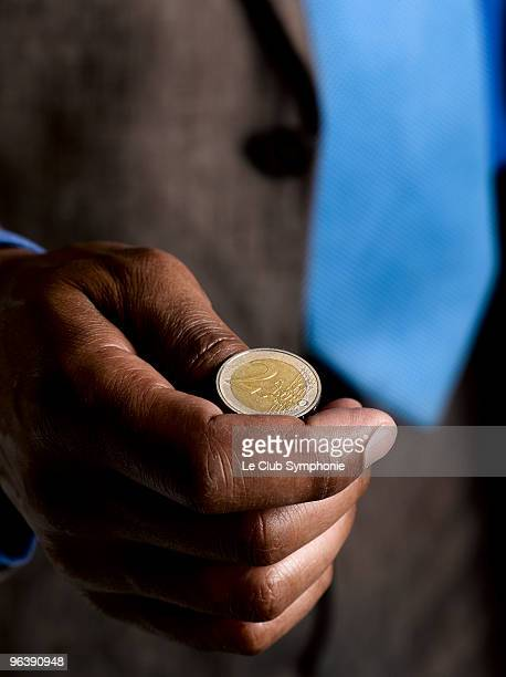 Business man ready to flip euro coin