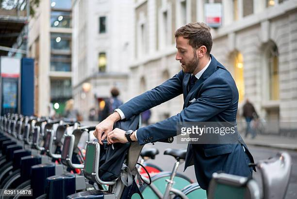 Business man renting a bike in London