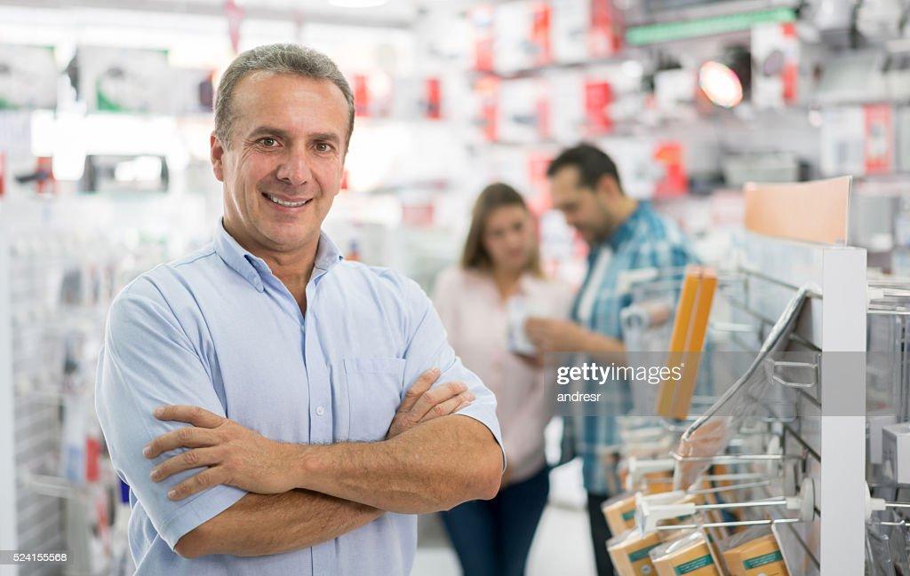 Business man running a technology store : Stock Photo