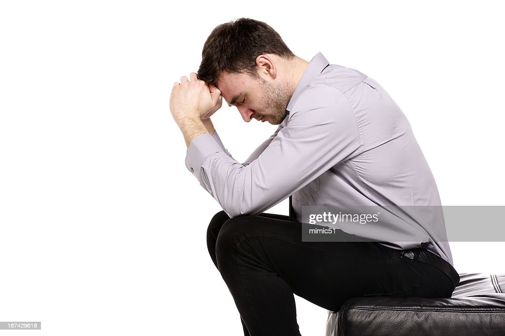Business man sat in despair isolated on a white background : Stock Photo