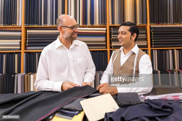 Business Man Selecting Fabric For a Custom Tailored Suit