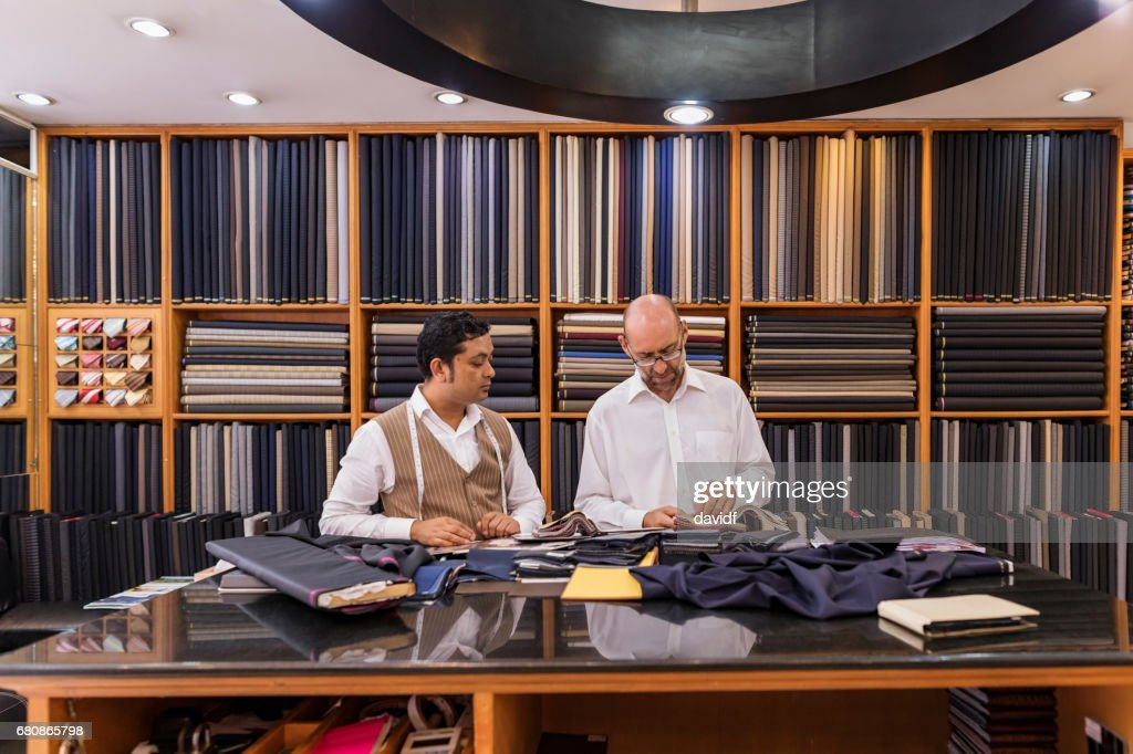 Business Man Selecting Fabric For a Custom Tailored Suit : Stock Photo