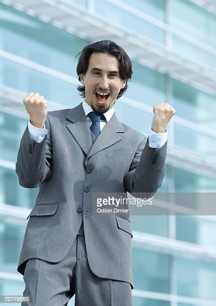 Business man shouting and making fists