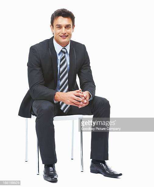 Business man sitting against white background