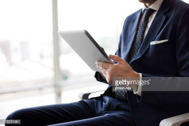 Business man sitting at airport
