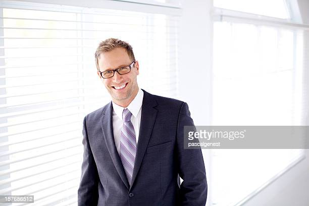 Business man smiling and wearing glasses