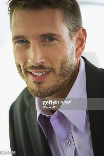Business man smiling, portrait, close-up