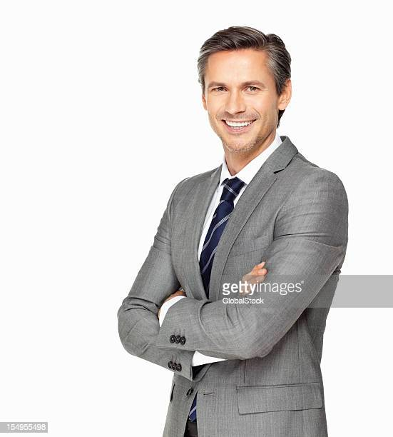 business man smiling with arms crossed - white background stockfoto's en -beelden