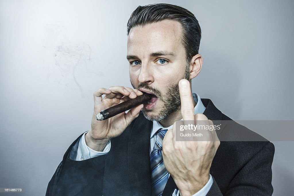 Business Man Smoking Cigar Stock Photo