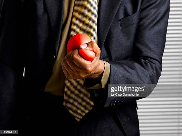 Business man squeezing stress ball