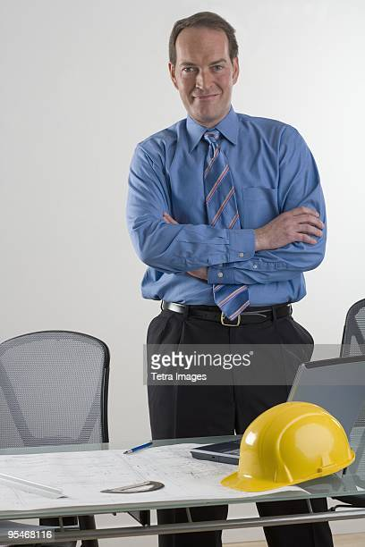 business man standing at computer